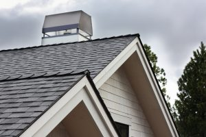 Roof eaves with fascia trim and chimney