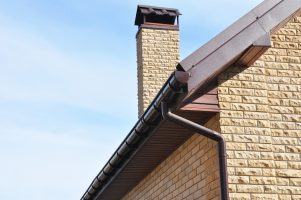 Rain Gutter Corner Repair. Roof Guttering installation with Chimney, Rain Chain Pipe and Holder.
